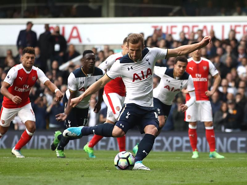 Kane stepped up to double Tottenham's lead from the penalty spot: Getty