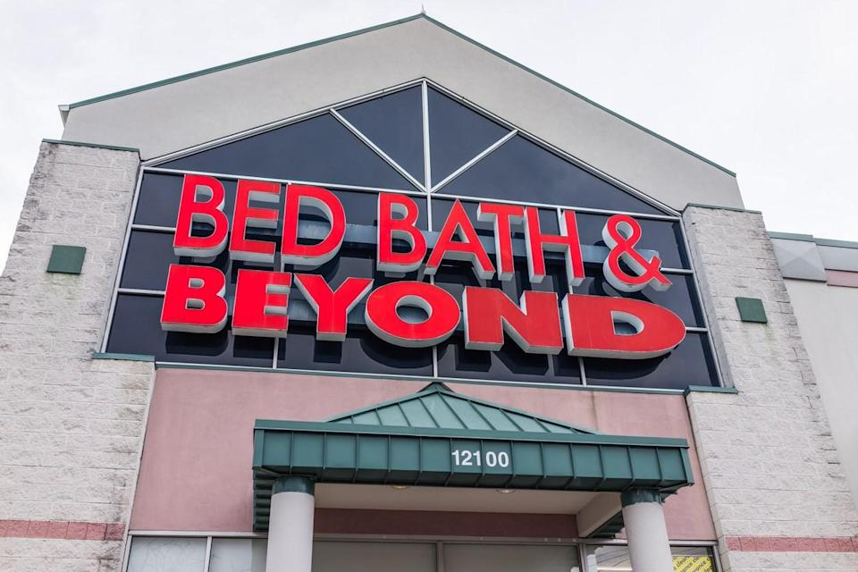 The exterior of a Bed Bath & Beyond store with red lettering