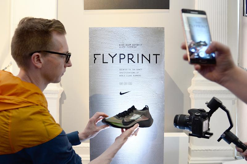 LONDON, ENGLAND - APRIL 17: Guests taking pictures at the launch of the Nike Zoom Vaporfly Elite Flyprint in London at The Institute of Contemporary Arts on April 17, 2018 in London, England. (Photo by Patrik Lundin/Getty Images for Nike)