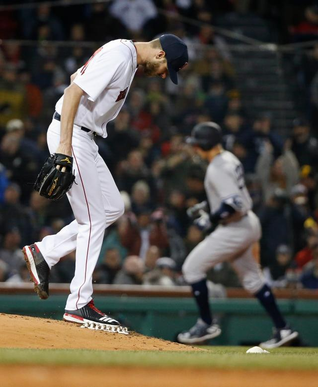 Boston Red Sox's Chris Sale kicks the mound after giving up a solo home run to New York Yankees' Aaron Judge during the fifth inning of a baseball game in Boston, Tuesday, April 10, 2018. (AP Photo/Michael Dwyer)