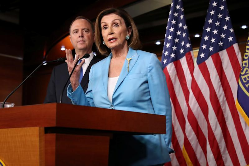 U.S. House Speaker Nancy Pelosi (D-CA) and House Intelligence Committee Chairman Adam Schiff (D-CA) address reporters during Pelosi's weekly news conference at the U.S. Capitol in Washington, U.S., October 2, 2019. REUTERS/Jonathan Ernst