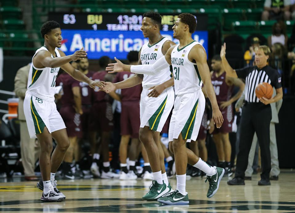 Baylor Bears guard Jared Butler (12) greets Mark Vital (11) and MaCio Teague (31) on the court during a game on Dec. 3, 2019. (Ray Carlin-USA TODAY Sports)