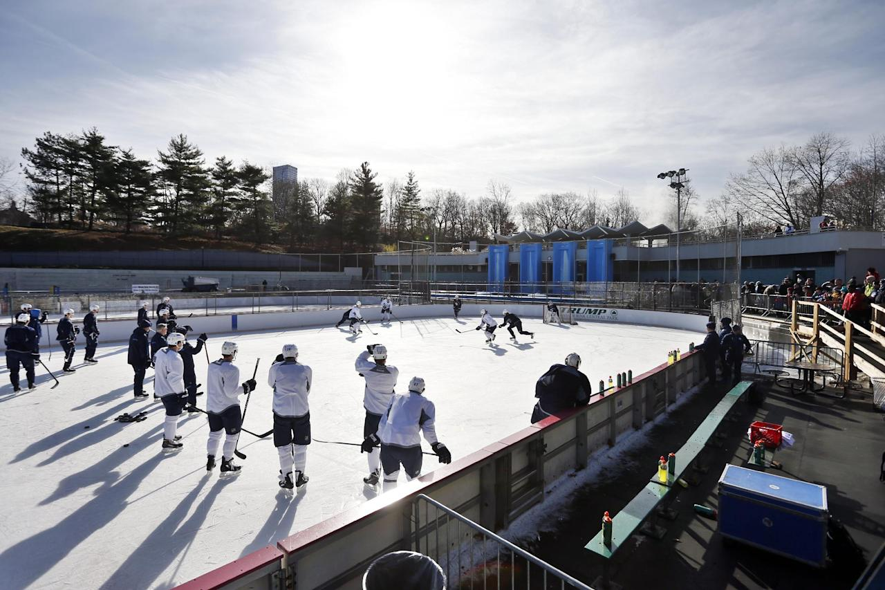 The Winnipeg Jets run a drill during NHL hockey practice at Lasker Rink in New York's Central Park, Saturday, Nov. 30, 2013. (AP Photo/Jason DeCrow)