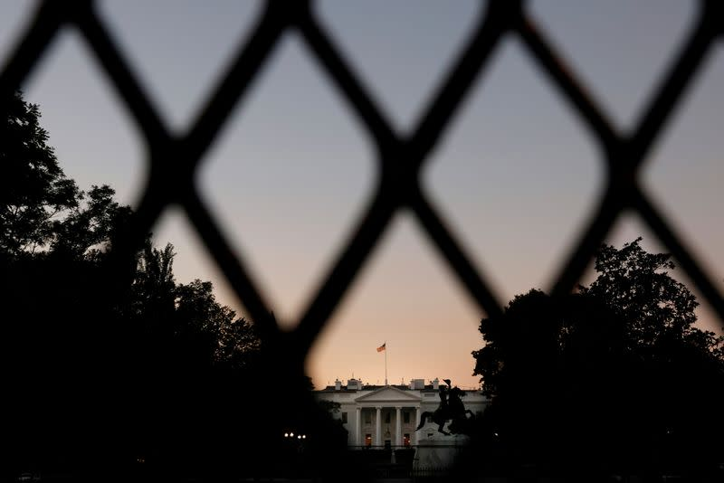 FILE PHOTO: The lights are on in the White House on a day that U.S. President Donald Trump has no scheduled public appearances while he continue fighting the coronavirus disease (COVID-19) in Washington