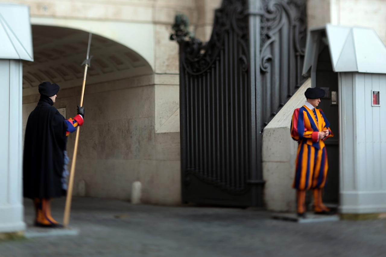 VATICAN CITY, VATICAN - FEBRUARY 26: (EDITORS NOTE; THIS DIGITAL IMAGE WAS CREATED USING A VARIABLE PLANE LENS)  Members of the Pope's Swiss Guard protect the gates to St Paul's Basilica on February 26, 2013 in Vatican City, Vatican. The Pontiff will hold his last weekly public audience on February 27, 2013 before he retires the following day. Pope Benedict XVI has been the leader of the Catholic Church for eight years and is the first Pope to retire since 1415. He cites ailing health as his reason for retirement and will spend the rest of his life in solitude away from public engagements.  (Photo by Christopher Furlong/Getty Images)