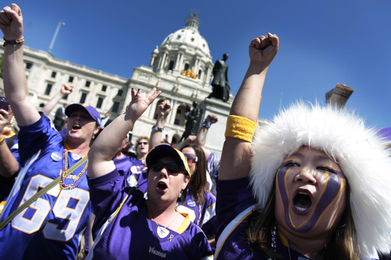 "Minnesota Vikings fan Erin Darsow, right, of Burnsville, Minn., attens a rally at the state Capitol in support of a new stadium for the NFL football team, Monday, May 7, 2012, in St. Paul, Minn. Supporters of a new Vikings stadium pleaded for votes in the Minnesota House on Monday, calling it their ""one chance"" to preserve the team's future in the state. (AP Photo/Star Tribune, Jerry Holt) ST. PAUL OUT MINNEAPOLIS-AREA TV OUT MAGS OUT"