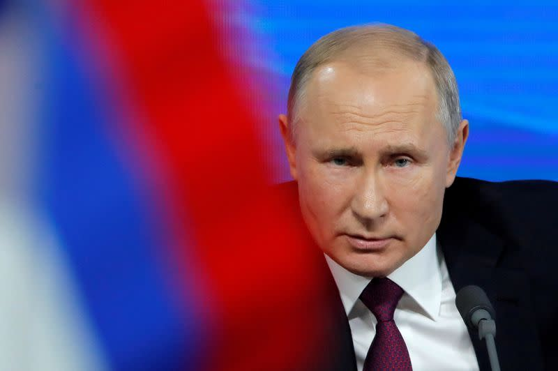 FILE PHOTO: Russian President Putin speaks during annual news conference in Moscow