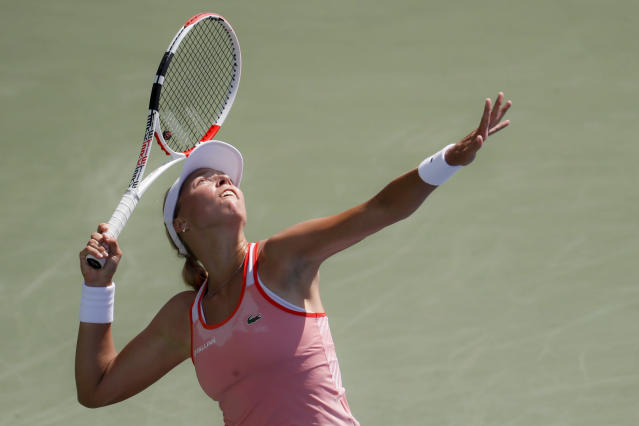 Anett Kontaveit, of Estonia, serves to Ashleigh Barty, of Australia, during the quarterfinals of the Western & Southern Open tennis tournament, Thursday, Aug. 15, 2019, in Mason, Ohio. (AP Photo/John Minchillo)
