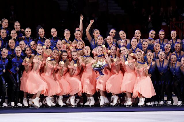 ISU World Synchronized Skating Championships 2019 - Helsinki, Finland - April 13, 2019. Second placed team Marigold Ice Unity from Finland, winner team Paradise from Russia and third placed team Helsinki Rockettes from Finland pose on the podium. Lehtikuva/Roni Rekomaa via REUTERS ATTENTION EDITORS - THIS IMAGE WAS PROVIDED BY A THIRD PARTY. NO THIRD PARTY SALES. NOT FOR USE BY REUTERS THIRD PARTY DISTRIBUTORS. FINLAND OUT. NO COMMERCIAL OR EDITORIAL SALES IN FINLAND.
