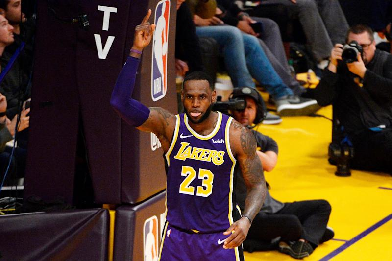 LeBron James gestures to celebrate his historic bucket Wednesday night. (Getty)