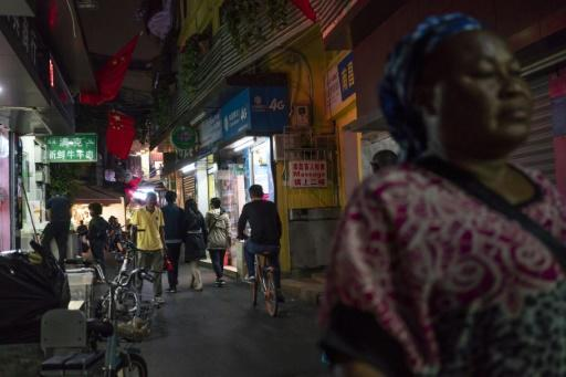 """Foreign traders and students in the """"Little Africa"""" district in Guangzhou, the capital of southern China's Guangdong province, say they face unfavourable visa rules and increasingly heavy policing"""