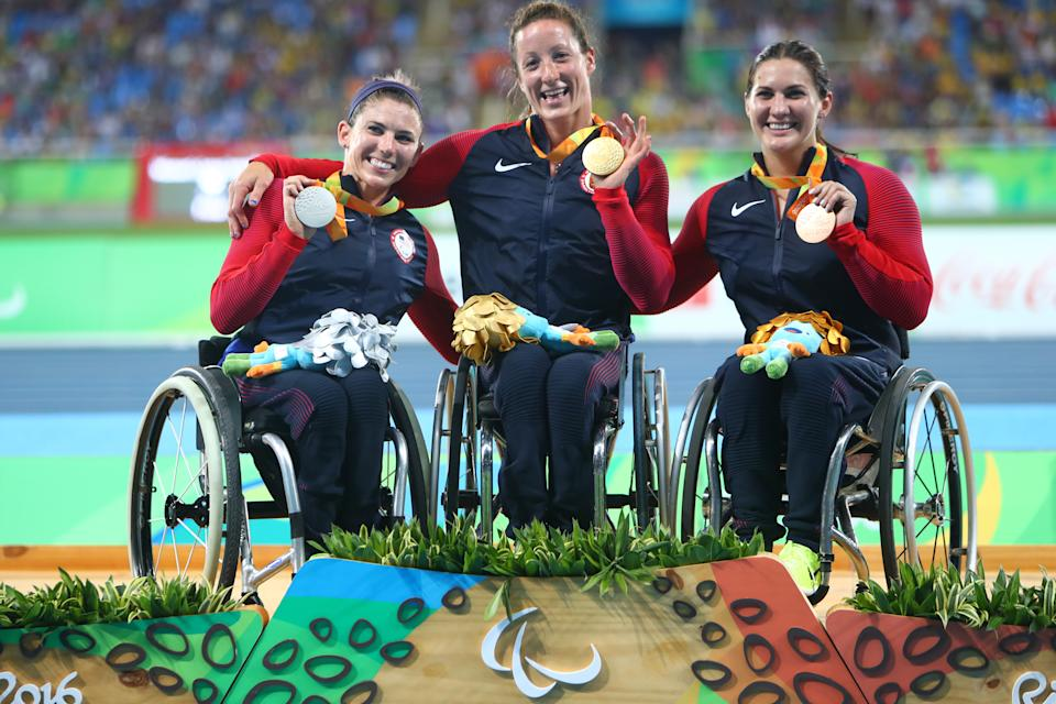 RIO DE JANEIRO, BRAZIL - SEPTEMBER 13:  (L-R) Silver medalist Amanda McGrory of United States, gold medalist Tatyana McFadden of United States and bronze medalist Chelsea McClammer of United States pose on the podium at the medal ceremony for men's Club Throw - F32 during day 6 of the Rio 2016 Paralympic Games at the Olympic Stadium on September 13, 2016 in Rio de Janeiro, Brazil. (Photo by Lucas Uebel/Getty Images)