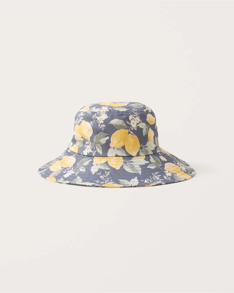 <p>Featuring a summery blue lemon print, this <span>Abercrombie &amp; Fitch Sun Shop Bucket Hat</span> ($29) is downright adorable. Psst, there's also <span>a matching top</span>.</p>