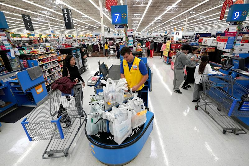 Gutierrez center checks out a customer at a Walmart Supercenter in Houston. On Thursday Jan. 31 2019 the Labor Department releases the employment cost index for the fourth quarter a measu