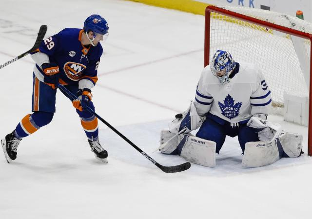 Toronto Maple Leafs goaltender Frederik Andersen (31) stops a shot on the goal by New York Islanders' Brock Nelson (29) during the third period of an NHL hockey game Monday, April 1, 2019, in Uniondale, N.Y. The Maple Leafs won 2-1. (AP Photo/Frank Franklin II)