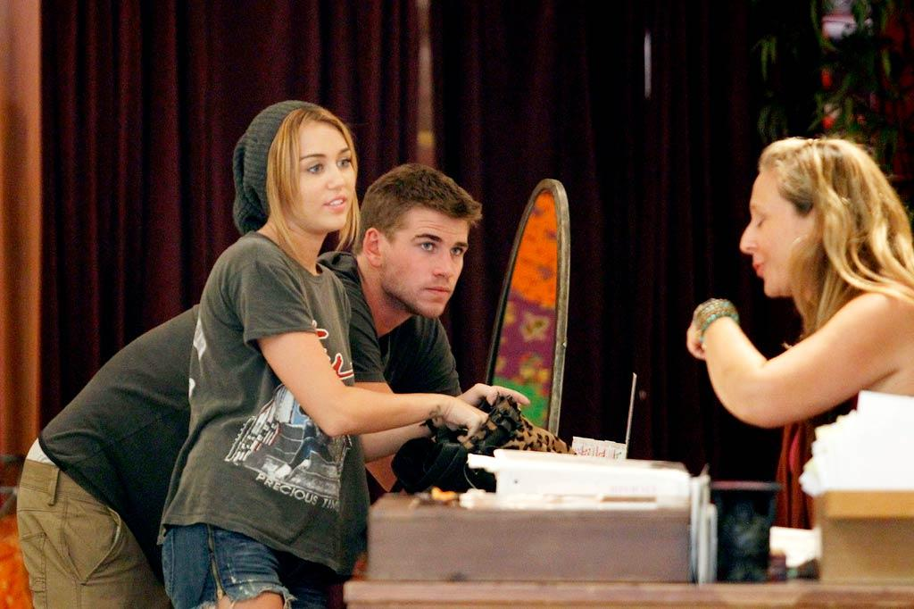 "When she returned to the U.S., Miley got back to chillin' with her boyfriend Liam, whose career is booming. Not only is the 21-year-old actor starring in the widely-anticipated ""The Hunger Games,"" but he's also landed roles in ""The Expendables 2"" and ""Arabian Nights."" (08/20/2011)"