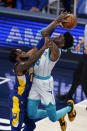 Charlotte Hornets' Jalen McDaniels (6) shoots over Indiana Pacers' Oshae Brissett (12) during the second half of an NBA basketball Eastern Conference play-in game Tuesday, May 18, 2021, in Indianapolis. (AP Photo/Darron Cummings)