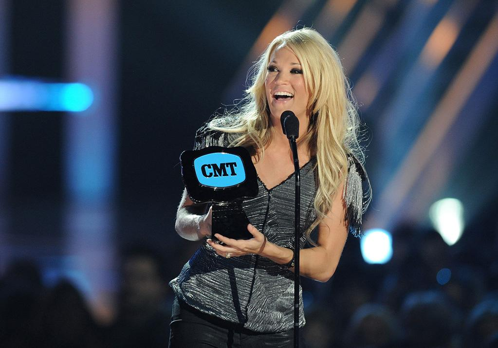 """Carrie Underwood was the big winner at the CMT Music Awards in Nashville Wednesday night, taking home Video of the Year and Performance of the Year honors. The country cutie told reports at the event that her hockey player fiance Mike Fisher was in charge of the couple's honeymoon plans. """"It's a surprise,"""" said Underwood, adding, """"I have no clue where we are going, which is nice. I know it will be warm, that's about it."""" Jason Merritt/<a href=""""http://www.gettyimages.com/"""" target=""""new"""">GettyImages.com</a> - June 9, 2010"""