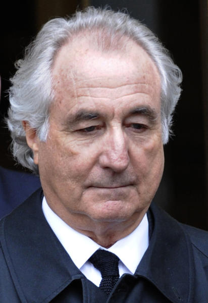 FILE - In this March 10, 2009 file photo, Bernard Madoff exits Manhattan federal court in New York. Madoff, who pleaded guilty in 2009 to orchestrating the largest Ponzi scheme in history, is seeking an early release from prison. The Department of Justice confirmed on Wednesday, July 24, 2019 that Madoff has a pending request to get his 150-year sentence reduced. (AP Photo/Louis Lanzano, File)
