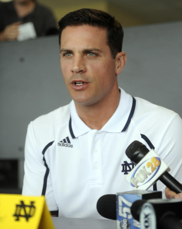 FILe - In this Aug. 22, 2013 file photo, Notre Dame defensive coordinator Bob Diaco answers questions from the media at NCAA college football media day in South Bend, Ind. Connecticut has hired Notre Dame defensive coordinator Bob Diaco as its football coach. The school announced the move early Thursday morning, Dec. 12, 2013.(AP Photo/Joe Raymond, File)