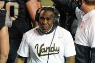 """Vanderbilt head coach Derek Mason watches from the sideline in the first half of an NCAA college football game against LSU Saturday, Oct. 3, 2020, in Nashville, Tenn. Southeastern Conference officials continue adapting to navigate setbacks in their pursuit of a league title and possible national championship. We hope to get through the end of the season,"""" Vanderbilt coach Derek Mason said of the SEC. """"But Im not a soothsayer, and I dont have a crystal ball. Im just trying to go day to day, week to week.(AP Photo/Mark Humphrey)"""