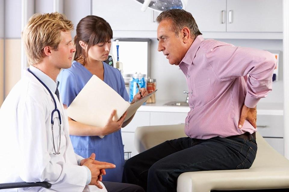 """One in nine men will be diagnosed with prostate cancer during their lifetime, according to the <a href=""""https://www.cancer.org/cancer/prostate-cancer/about/key-statistics.html"""" rel=""""nofollow noopener"""" target=""""_blank"""" data-ylk=""""slk:American Cancer Association"""" class=""""link rapid-noclick-resp"""">American Cancer Association</a>. And while it ranks second to skin cancer <a href=""""https://bestlifeonline.com/lifetime-cancer-risk/?utm_source=yahoo-news&utm_medium=feed&utm_campaign=yahoo-feed"""" rel=""""nofollow noopener"""" target=""""_blank"""" data-ylk=""""slk:in terms of prevalence"""" class=""""link rapid-noclick-resp"""">in terms of prevalence</a> amongst men, unlike skin cancer, which can often be identified with the naked eye, symptoms of prostate cancer can be much harder to pinpoint when the disease is in its early stages. """"Prostate cancer doesn't usually have symptoms until it's in its later stages,"""" Virginia-based urologist <strong>Jennifer Young</strong>, MD, told the <a href=""""https://www.youtube.com/watch?v=xib64-DPj78"""" rel=""""nofollow noopener"""" target=""""_blank"""" data-ylk=""""slk:StoneSprings Hospital Center"""" class=""""link rapid-noclick-resp"""">StoneSprings Hospital Center</a>. """"That's why screening with the prostate-specific antigen (PSA) blood test, and sometimes the digital rectal exam, are recommended."""" In addition to getting regular screenings, doctors recommend keeping an eye out for the following symptoms of prostate cancer and notifying your doctor immediately if you think there is something wrong. <div class=""""number-head-mod number-head-mod-standalone""""> <h2 class=""""header-mod""""> <div class=""""number"""">1</div> <div class=""""title"""">Chronic lower back pain</div> </h2> </div>"""