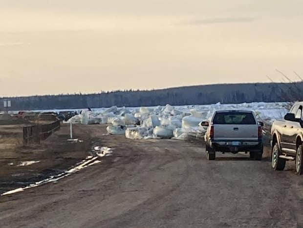 The swell of water and ice has blocked some roads in Fort Simpson.