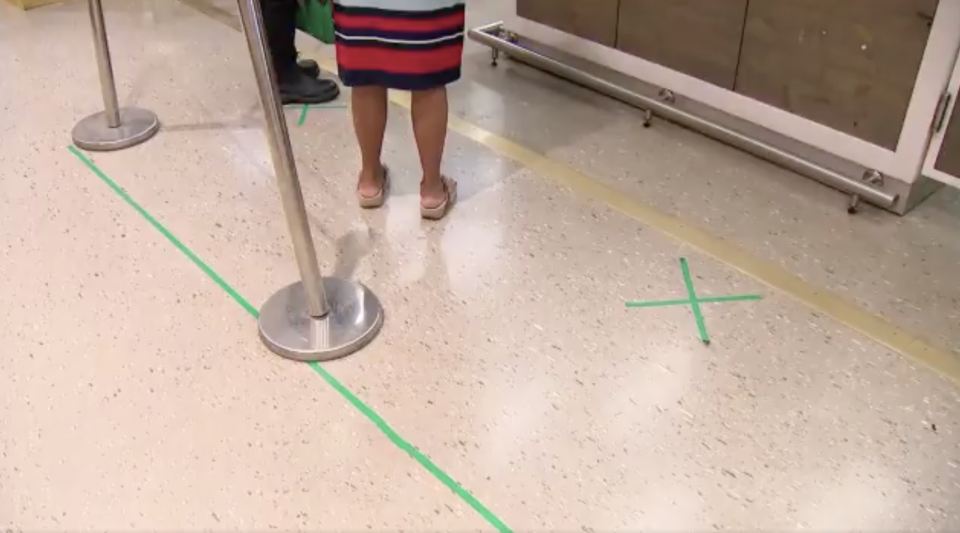 A cross on the ground of a Woolworths supermarket is pictured.