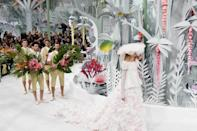 <p>An origami minefield was the stage for the Chanel Couture Spring show. A magical paper wonderland made even more wonderful by the interjectory male models who carried branches of flowers behind every couture clad maiden. </p>