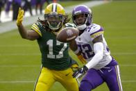 Minnesota Vikings' Mark Fields breaks up a pass intended for Green Bay Packers' Davante Adams during the first half of an NFL football game Sunday, Nov. 1, 2020, in Green Bay, Wis. (AP Photo/Mike Roemer)