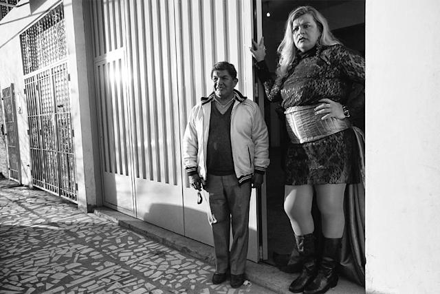 <p>Serena stands at the entrance to the ballroom with her friend Miguel Angel, waiting for the guests to arrive at her birthday party. (Copyright © 2018 by Kike Arnal. These images originally appeared in Revealing Selves: Transgender Portraits from Argentina, published by The New Press. Reprinted here with permission.) </p>