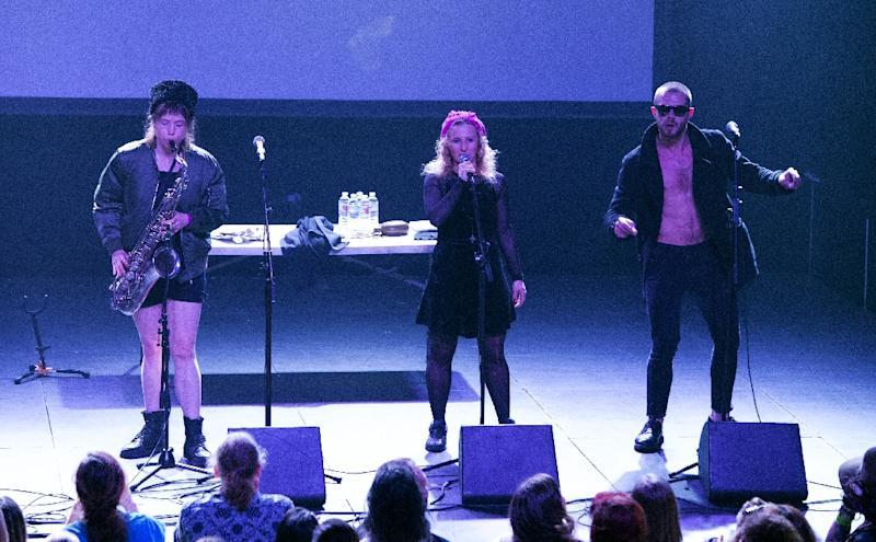 (L-R) Nastya, Maria Alyokhina and Kyril Kanstansinau of Russian Band Pussy Riot perform onstage at the Fonda Theater in Hollywood, California (AFP Photo/VALERIE MACON)