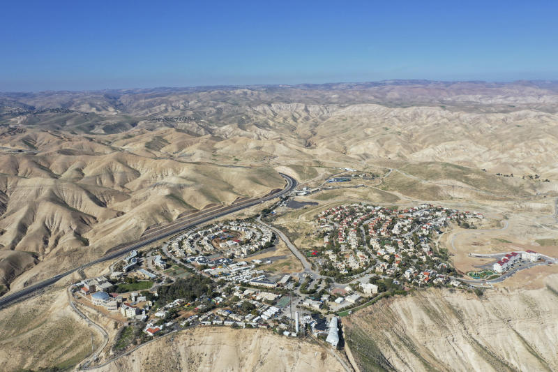 FILE - This Jan. 26, 2020, file photo, shows the view of the West Bank Jewish settlement of Mitzpe Yeriho. As President Donald Trump presented a Mideast plan favorable to Israel, Prime Minister Benjamin Netanyahu on Tuesday, Jan. 28, announced plans to move ahead with the potentially explosive annexation of large parts of the occupied West Bank, including dozens of Jewish settlements. (AP Photo/Oded Balilty, File)