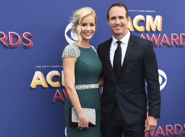 """FILE - In this April 15, 2018 file photo, Brittany and Drew Brees arrive at the 53rd annual Academy of Country Music Awards at the MGM Grand Garden Arena in Las Vegas. New Orleans Saints Quarterback Drew Brees has apologized for comments he made in an interview regarding his opposition to Colin Kaepernick's kneeling during the national anthem. His wife apologized on Saturday, June 6, 2020, as well, saying """"we are the problem."""" (Photo by Jordan Strauss/Invision/AP, File)"""