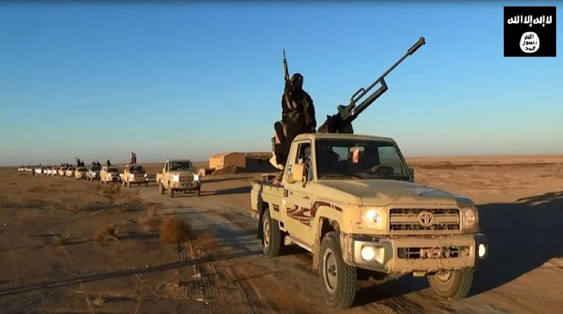 An image grab taken from a propaganda video uploaded on June 11, 2014 by the Islamic State jihadist group allegedly shows militants driving at an undisclosed location in Iraq's Nineveh province (AFP Photo/)