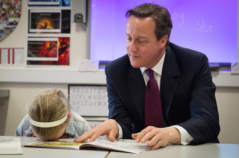 David Cameron holds the class at the Sacred Heart Roman Catholic Primary school, Westhoughton.