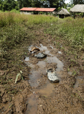 Abandoned Crocs near the improvised temple where a pregnant woman, five of her children and a neighbour were killed.