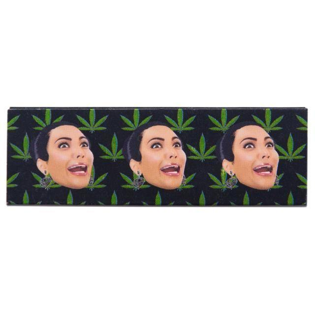 <p>To match your 'ass tray' you can even roll your own cigarettes with Kim's face. Copyright: [Kimoji] </p>