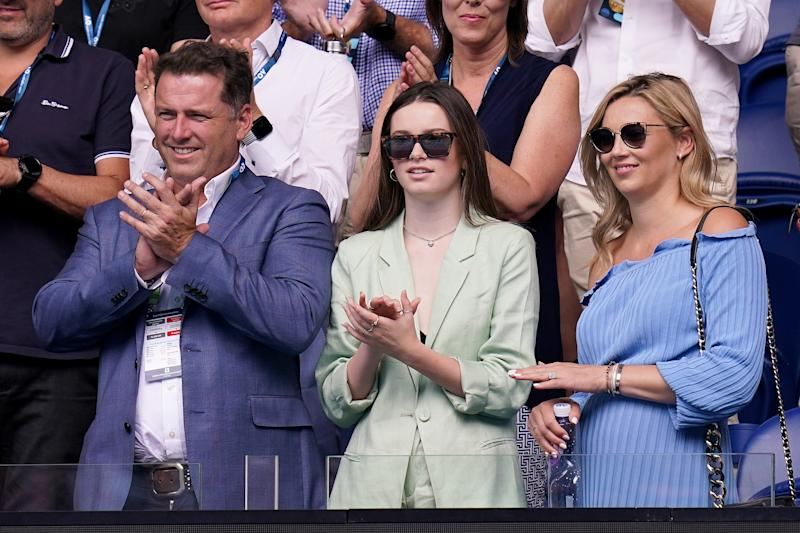 Karl Stefanovic, daughter Ava and wife Jasmine Yarbrough clap in the stands at the Australian Open