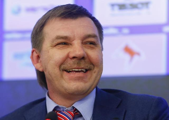 Oleg Znarok, new head coach of the Russian national hockey team smiles while answering a question during a news conference in Moscow, Russia, Friday March, 28, 2014. Oleg Znarok has been hired as Russia's new hockey coach, taking over a team that failed to win a medal at the Sochi Olympics. (AP Photo/Denis Tyrin)