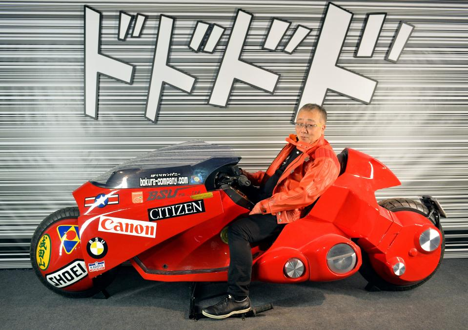 Japanese manga artist Katsuhiro Otomo, who is this year's festival's guest of honor, poses on a replica of his Akira anime's motorbike on the eve of the 43rd Angouleme International Comics Festival on January 27, 2016 in Angouleme. (Photo by GEORGES GOBET / AFP) (Photo by GEORGES GOBET/AFP via Getty Images)