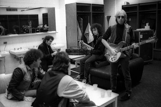 <p>From left: Howie Epstein, Benmont Tench, Stan Lynch, Mike Campbell, and Tom Petty backstage at Nassau Coliseum in 1990 in Uniondale, N.Y. (Photo: Ebet Roberts/Redferns) </p>