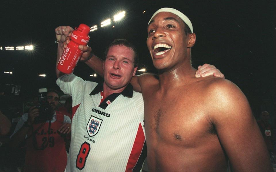 Paul Gascoigne (L) and a topless Paul Ince (R) - GETTY IMAGES