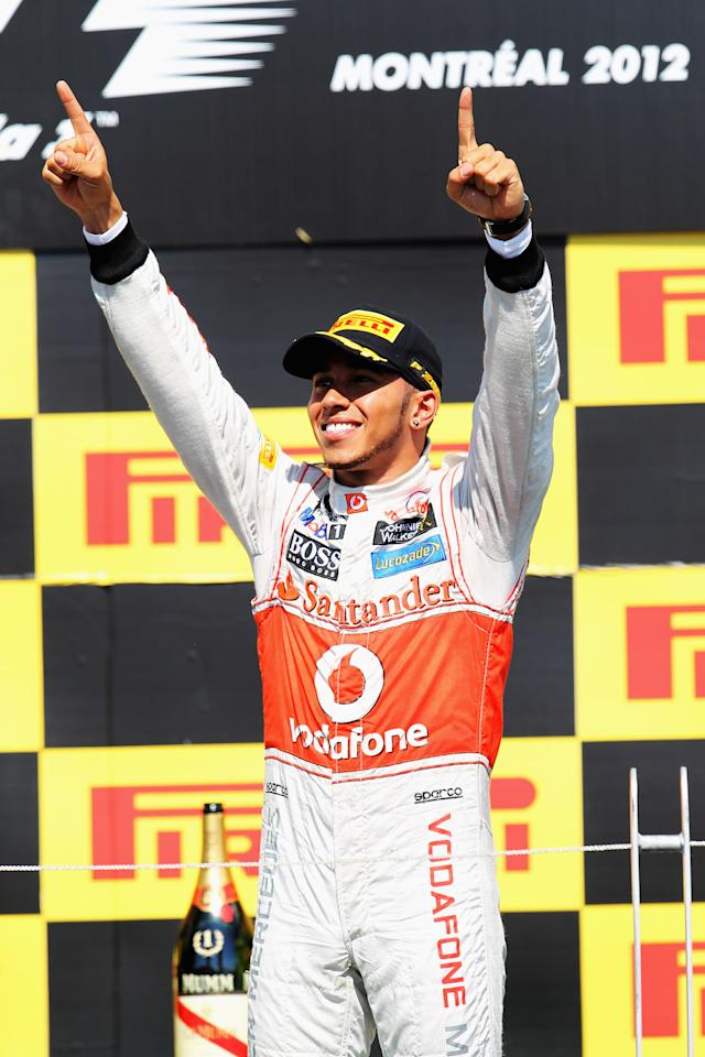 MONTREAL, CANADA - JUNE 10:  Lewis Hamilton of Great Britain and McLaren celebrates on the podium after winning the Canadian Formula One Grand Prix at the Circuit Gilles Villeneuve on June 10, 2012 in Montreal, Canada.  (Photo by Mark Thompson/Getty Images)