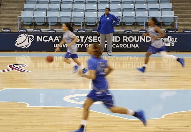 Hampton assistant coach Barbara Burgess, center rear, coaches her team during practice at the NCAA women's college basketball tournament in Chapel Hill, N.C., March 22, 2014. Hampton plays Michigan State in a first-round game on Sunday. (AP Photo/Ellen Ozier)