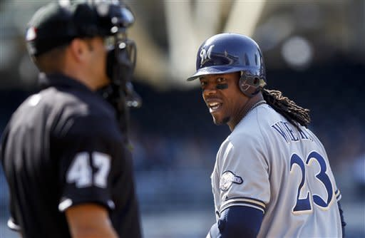 Milwaukee Brewers' Rickie Weeks has words for home plate umpire Mark Wegner after being called out on strikes on the first inning against the San Diego Padres during a baseball game, Wednesday, May 2, 2012, in San Diego. (AP Photo/Lenny Ignelzi)
