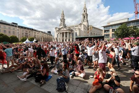 FILE PHOTO: World Cup - England fans watch Sweden vs England - Millennium Square, Leeds,Britain - July 7, 2018 England fans celebrate victory after the match REUTERS/Jon Super/File Photo