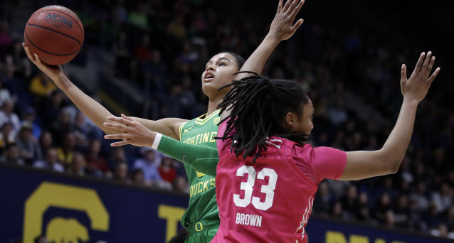 FILE - In this Friday, Feb. 21, 2020, file photo, Oregon's Satou Sabally, left, shoots past California's Jaelyn Brown (33) in the first half of an NCAA college basketball game in Berkeley, Calif. Sabally has submitted paperwork to enter the WNBA draft, which is scheduled to be held April 17, 2020. (AP Photo/Ben Margot, File)