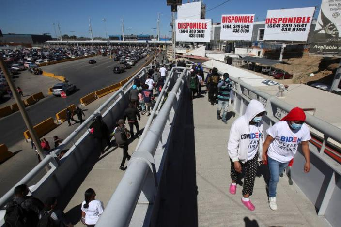 Migrants protest at the Mexico-U.S. San Ysidro point of entry in Tijuana