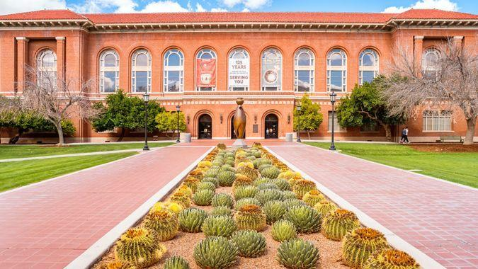 Students walk in front of the Arizona State Museum on the University of Arizona Campus in Tucson Arizona USA.